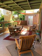 Deck is accessible from the living room and kitchen areas.