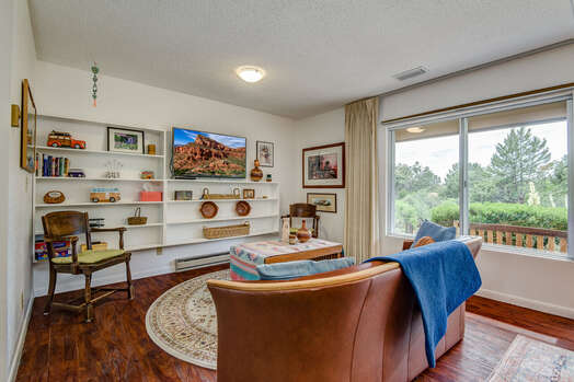 Family Room with a Smart TV and Cable Programming, and a Large Picture Window