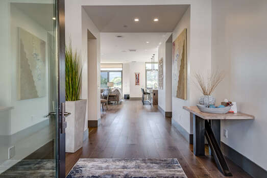 Enter into Two Levels of Pure Luxury, Professionally Decorated Boasting Stunning Hardwood Flooring Throughout