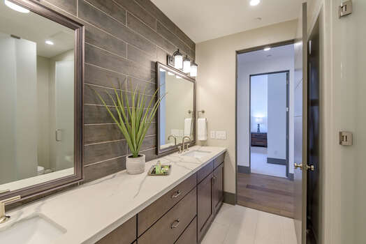 Full Shared Bath with Dual Quartz Counter Sinks and a Tile Shower