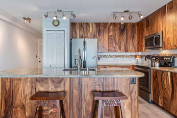 Remodeled kitchen includes a breakfast bar
