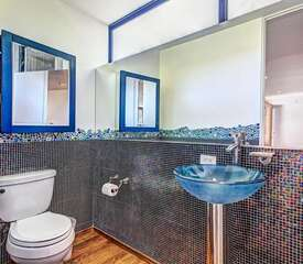 Powder room by entrance with bidet.