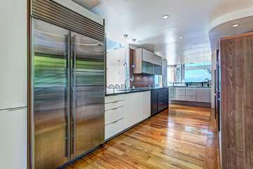 Kitchen with large refrigerator,
