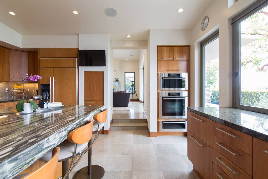 Zen and ready for you. Pocket window in kitchen opens to entertain and serve outside.