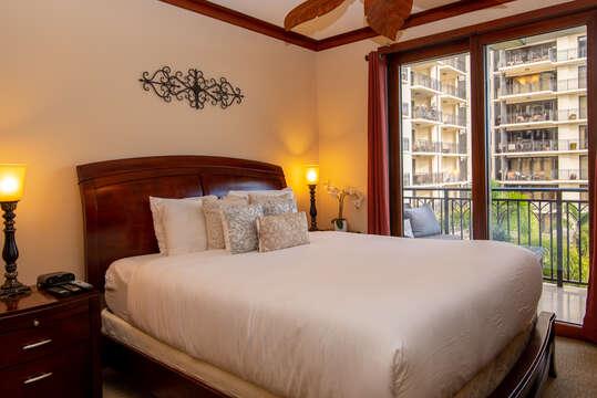 Single bedroom with sliding glass door to balcony