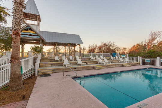Pool, Pool Cabana, Loungers, and Outdoor Chairs.