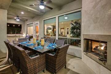 Dine by the outdoor fireplace