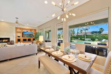 Huge windows to keep an eye on kids in the pool from the living room & kitchen