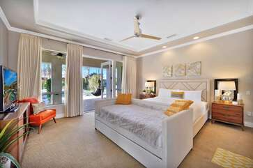 The master bedroom has convenient French doors that lead to the back pool/game area Bedroom 1