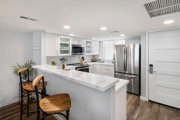 Fully Equipped Kitchen with Refrigerator and Microwave