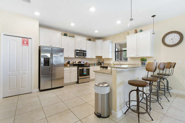 Cook gourmet meals in the the fully equipped kitchen with stainless steel appliances