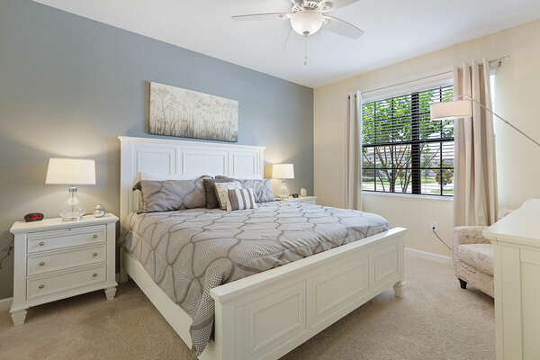 A second master suite complete with a king-sized bed