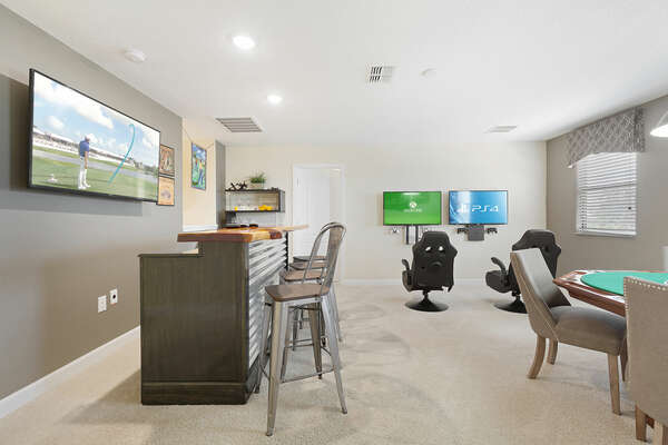 Located upstairs, the loft game room is great for entertaining the whole family