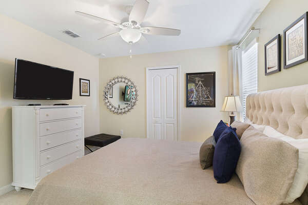 This bedroom includes a SMART TV and ceiling fan for ultimate comfort