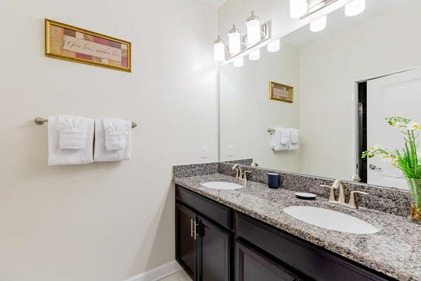 The shared ground floor bathroom features a dual vanity and shower