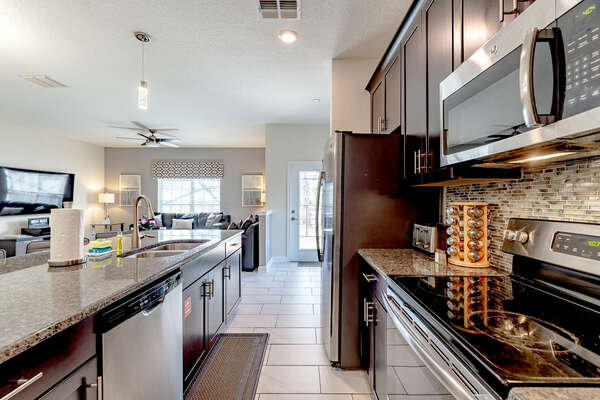 Cook a savory dinner in the fully equipped kitchen featuring stainless steel appliances