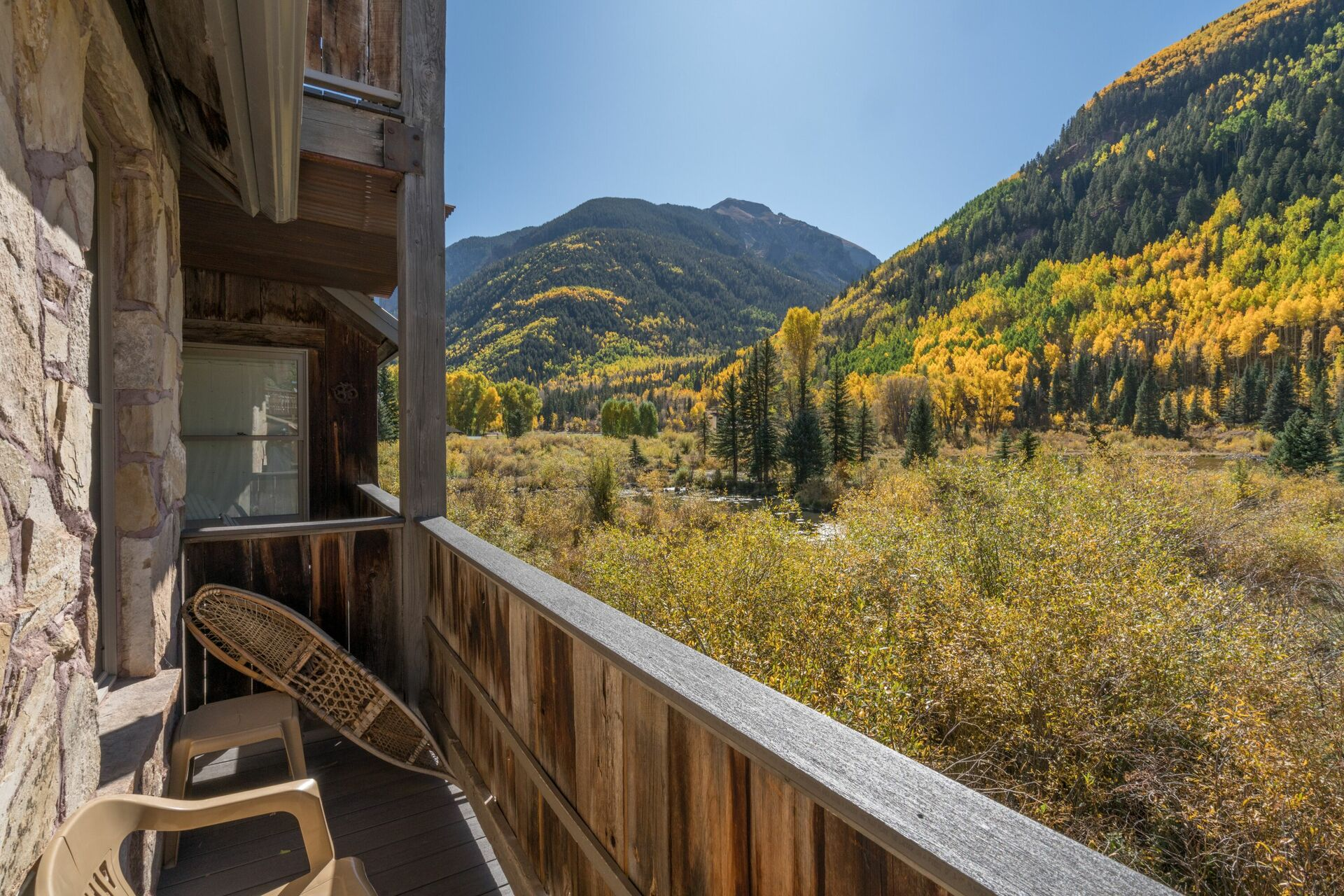 Patio furniture on the balcony of this 3 bedroom condo in Telluride.