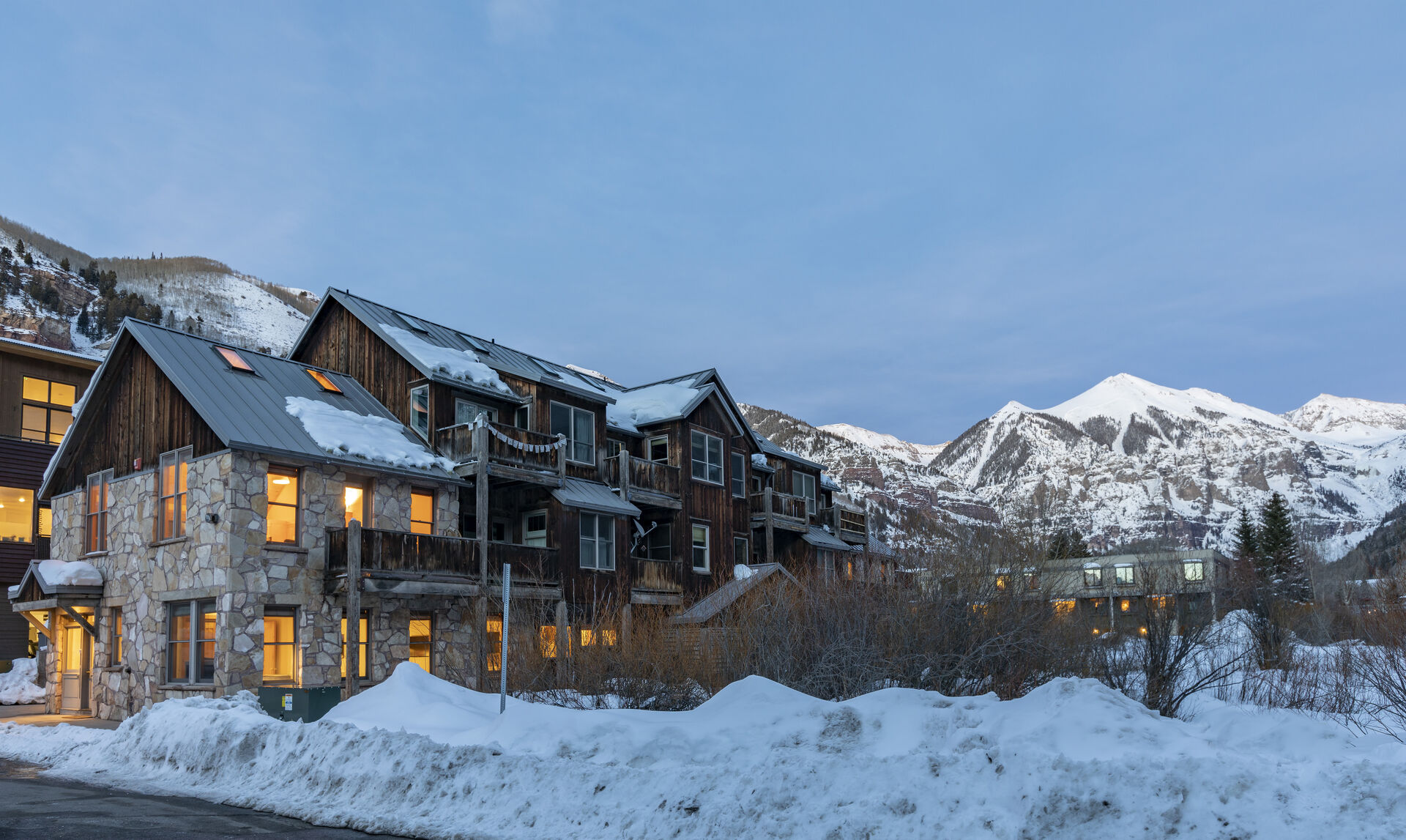 A snowy view of the exterior of this 3 bedroom condo in Telluride.