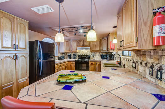 Remodeled Kitchen with Custom Cabinets and Stunning Tile Counters and Backsplash