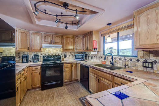 Spacious Fully Equipped Kitchen with Exterior Views and Natural Light
