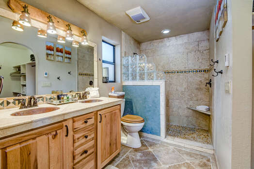 Master Bath with Copper Sinks and a Tile Shower