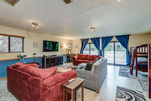 Garage Converted to Bonus Room with Two Twin over Twin Bunk Beds, a Twin Sleeper Sofa and a 65