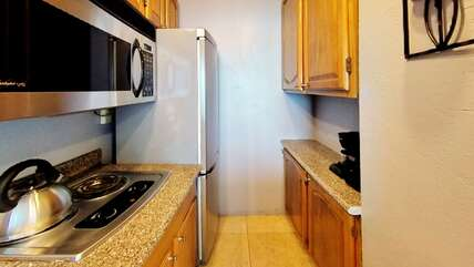 Double stove, full-size fridge, microwave, coffee maker, toaster and kettle.