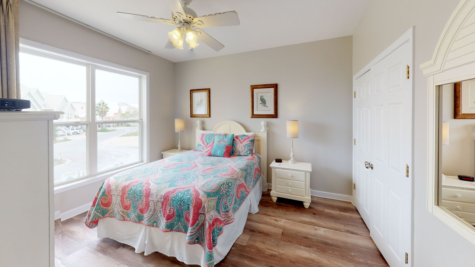 Spacious Bedroom Has Large Bed and Beautiful Floors.