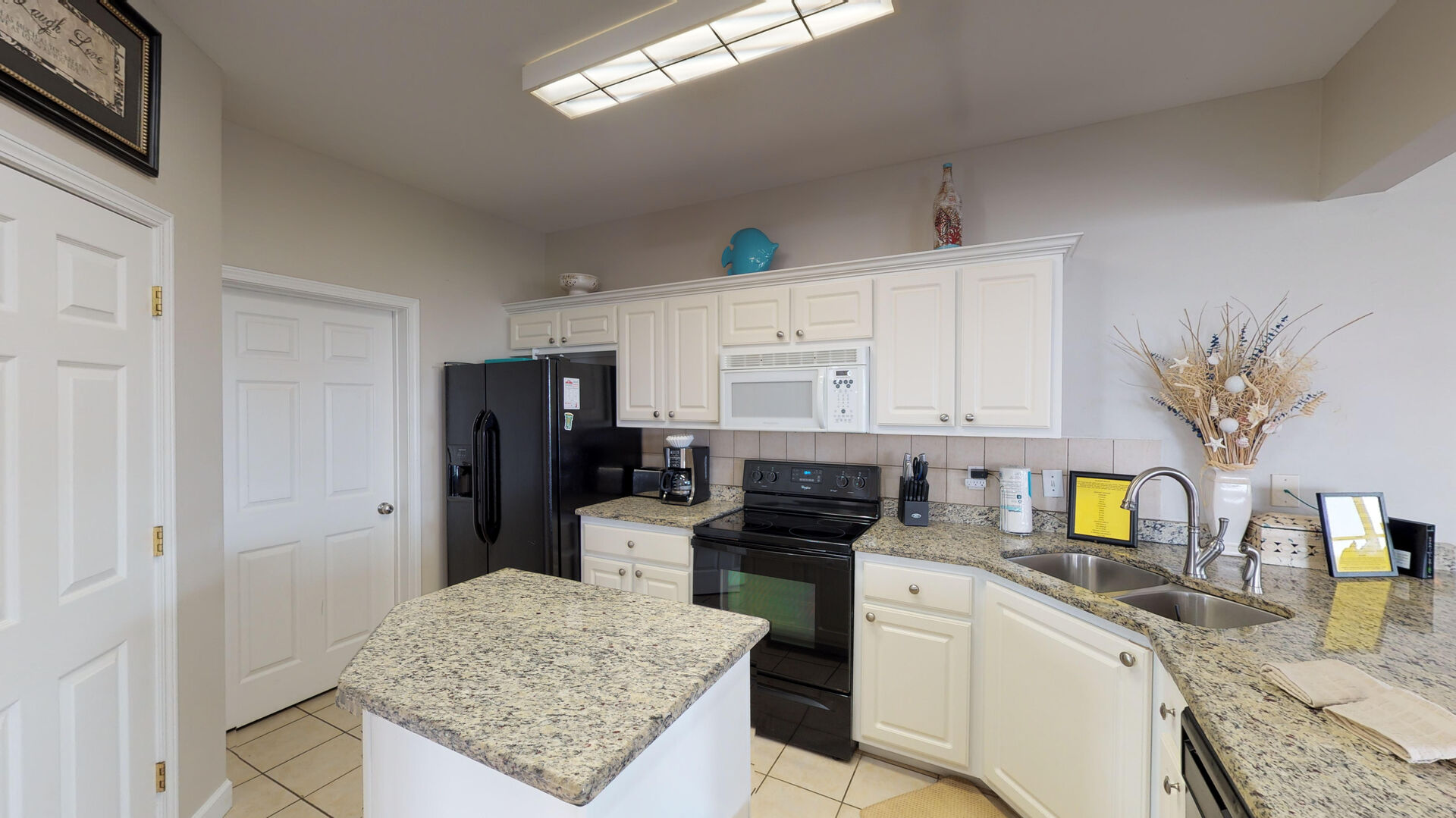 Spacious Kitchen Features Plenty of Counter and Cabinet Space.