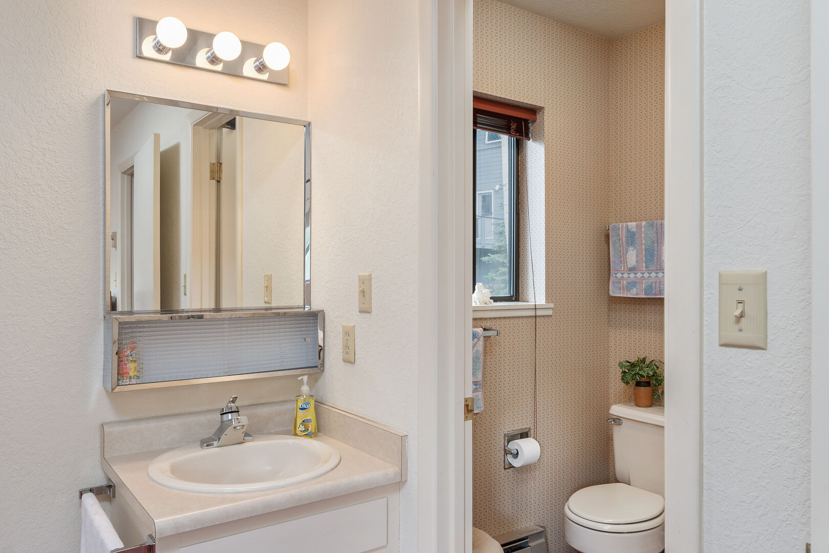 Shared full bathroom between 2nd and 3rd bedroom