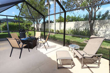 Screened lanai with fire pit and seating