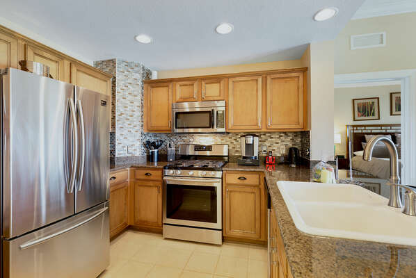 Cook delicious meals in the fully equipped kitchen with stainless steel appliances