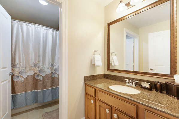 Bedroom 2 and 3 share this charming bathroom with walk-in shower