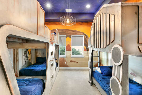 This bedroom features 3 sets of bunk beds