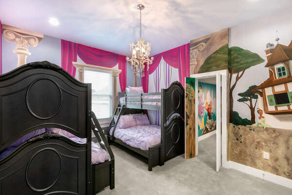On the other size of the play zone you will find this royal bedroom