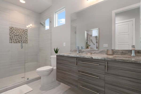 Get ready in this chic bathroom with plenty of privacy and space