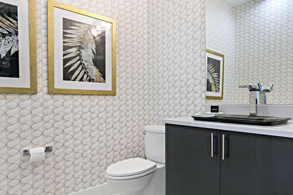 Elegant downstairs hallway bathroom