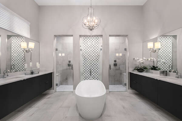 Beautiful master bathroom with a garden tub and His and Her showers