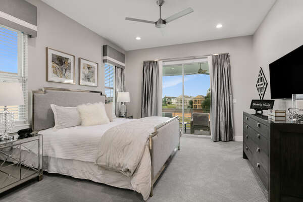 Elegant master suite with access to the second floor balcony
