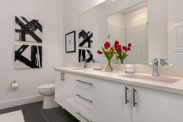 A large vanity mirror perfect for getting ready in the ensuite bathroom
