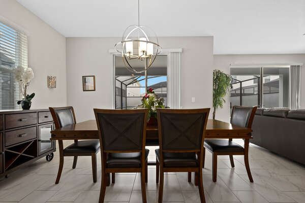 The formal dining table has seating for 6