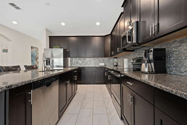 The kitchen has stainless steel appliances