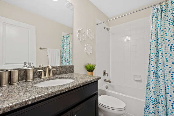 Has a combination shower and tub