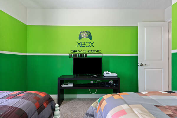 Featuring an Xbox One and TV