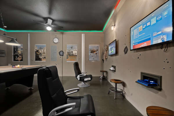 Gaming area with gaming chairs and video game consoles