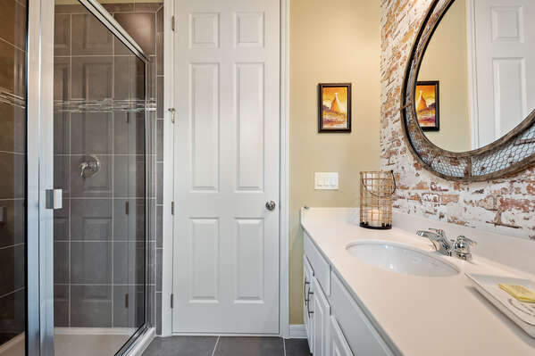 The ensuite has a walk-in shower and vanity
