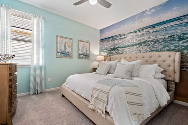 Large king-size bed with a coastal theme