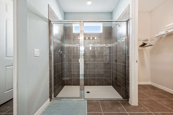 The large ensuite bathroom has a walk-in shower