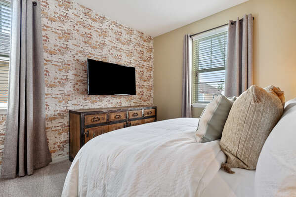 This room has a king-size bed and TV