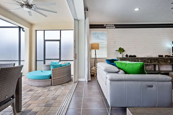 Open the screen and bring together your living area and outside patio